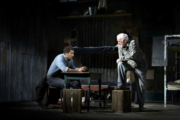 James Franco and Jim Norton perform a scene from John Steibeck's Of Mice and Men, directed by Anna D. Shapiro, at the Longacre Theatre. Violet the dog hangs upstage.