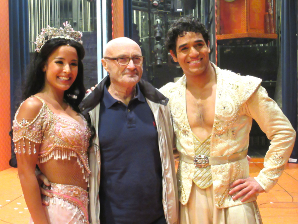 Aladdin's Courtney Reed and Adam Jacobs pose with singer-songwriter Phil Collins.