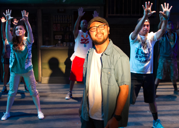 Joshua Lopez as Usnavi with the cast of In the Heights, directed by Oanh Nguyen, at Chance Theater.