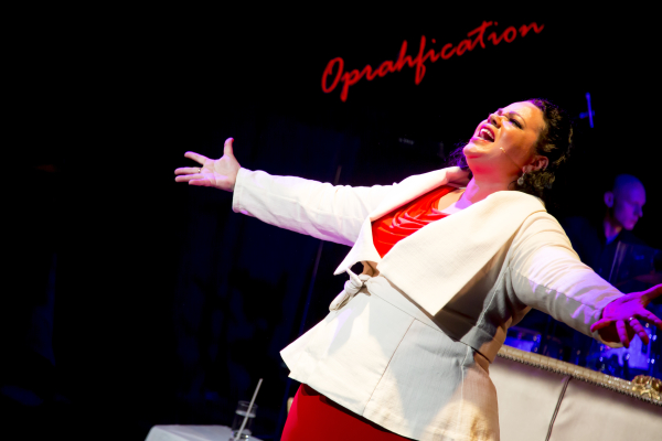 Rachel Dunham as Oprah in Oprahfication, written by Dunham and directed by Dirk Hoult, at the Pershing Square Signature Center as part of the 2014 New York Musical Theatre Festival.