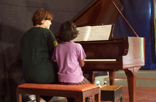 Mary-Mitchell Campbell plays the piano with an ASTEP participant.