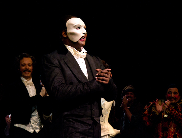 Norm Lewis, Broadway's newest Phantom, dons the legendary white mask.