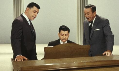 Busker Alley composers Robert and Richard Sherman with their frequent creative collaborator Walt Disney.