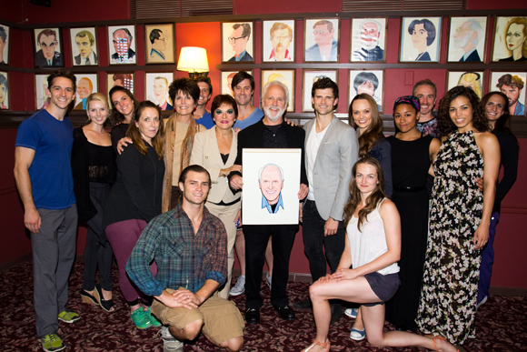 John Rubinstein (center) with cast members of the Broadway and touring company of Pippin.