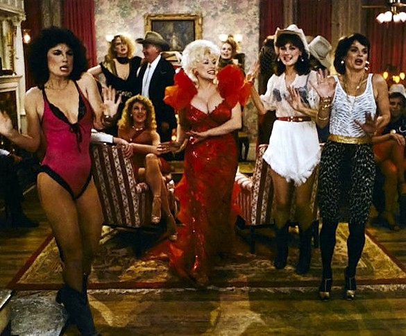 Dolly Parton (center) and the cast of the film adaptation of The Best Little Whorehouse in Texas.
