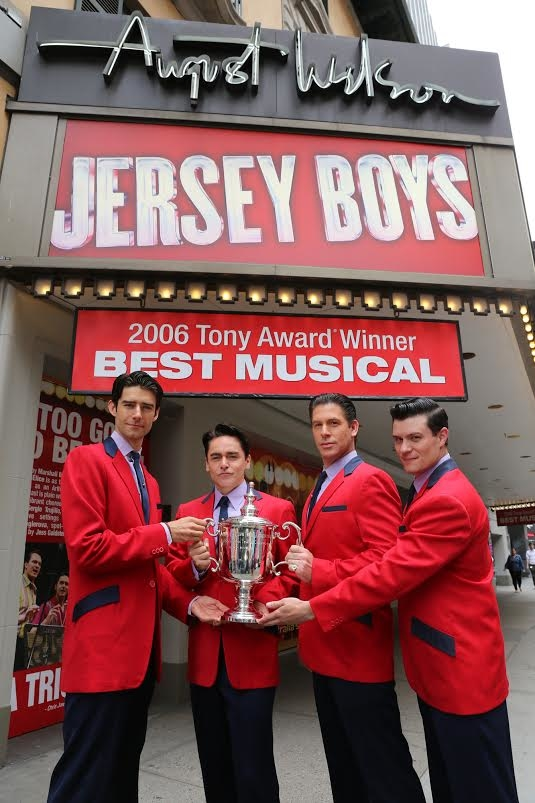 Jersey Boys stars Drew Gehling, Ryan Molloy, Richard H. Blake, and Nathan Scherich with the US Open Champion Trophy.
