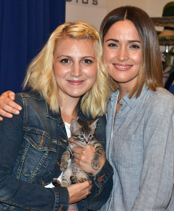 Annaleigh Ashford and Rose Byrne pose with one of the cats auditioning to appear in You Can't Take It With You.