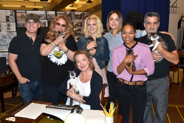 Director Scott Ellis poses with cat-holding members of the cast of You Can't Take It With You, set to bow on Broadway for the first time in 30 years.