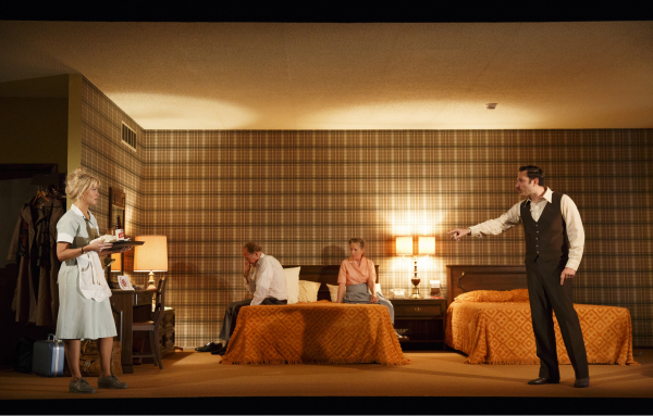 Jenn Lyon as Sharon, Jon DeVries as Frank, Lizbeth MacKay as Jessie, and Quincy Dunn-Baker as Ray in Signature Theatre's production of A.R. Gurney's The Wayside Motor Inn, directed by Lila Neugebauer, at the Pershing Square Signature Center.