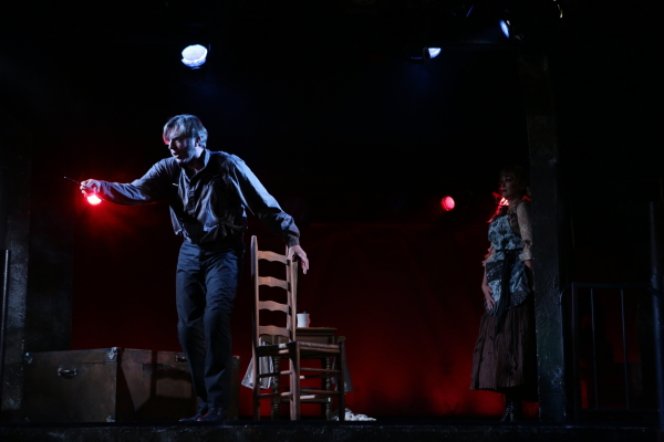 Christopher Chew as Sweeney Todd and Amelia Broome as Mrs. Lovett in Stephen Sondheim and Hugh Wheeler's Sweeney Todd, directed by Spiro Veloudos, at Lyric Stage Company of Boston.