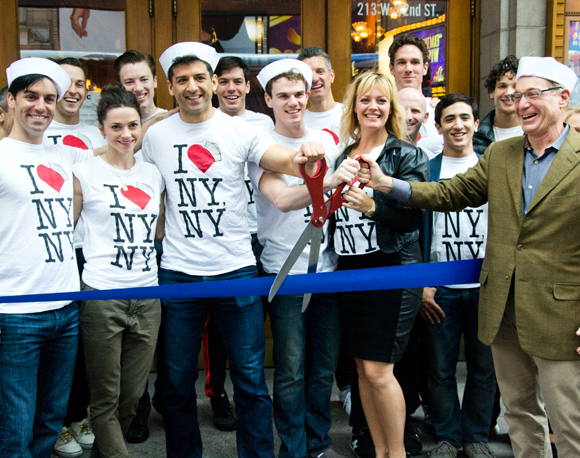 On the Town producer Howard Kagan (right) cuts the ribbon as stars Clyde Alves, Megan Fairchild, Tony Yazbeck, Jay Armstrong Johnson, and Elizabeth Stanley look on.