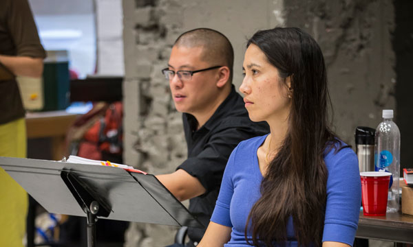Playwright Francis Ya-Chu Cowhig with Director Eric Ting in rehearsal for the world premiere production of The World of Extreme Happiness at Chicago's Goodman Theatre.