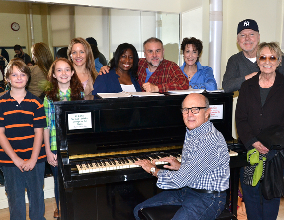 The cast of A Christmas Memory with composer Larry Grossman (at the piano), lyricist Carol Hall and book writer Duane Poole (standing, right).
