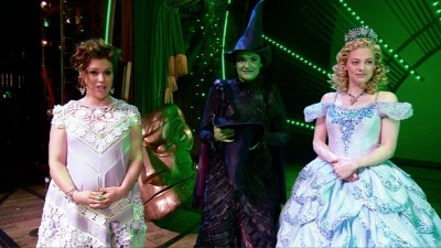 Alyssa Milano with Wicked stars Christine Dwyer and Jenni Barber onstage at the Gershwin Theater.