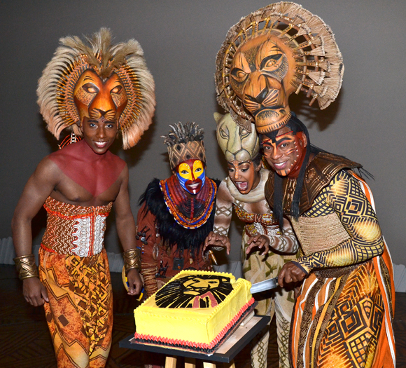 Mufasa cuts the cake — and his castmates can't wait to eat it.