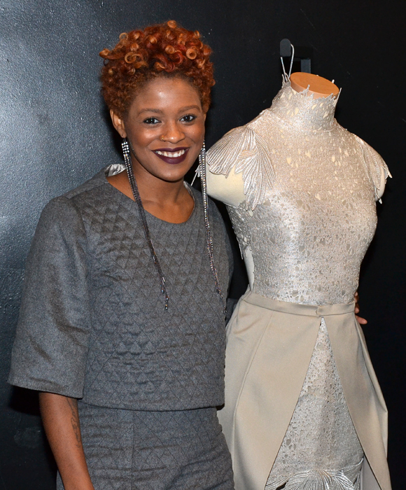Project Runways: All Stars designer Sonjia Williams with her winning dress, inspired by Broadway's Wicked.