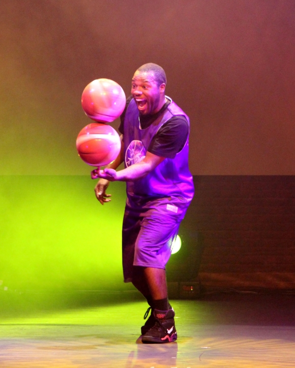 Basketball freestyler Rashaun Daniels spins two basketballs on one finger in 360 Allstars.
