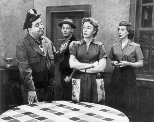 Jackie Gleason as Ralph Kramden, Art Carney as Ed Norton, Audrey Meadows as Alice Kramden, and Joyce Randolph as Trixie in a scene from The Honeymooners.