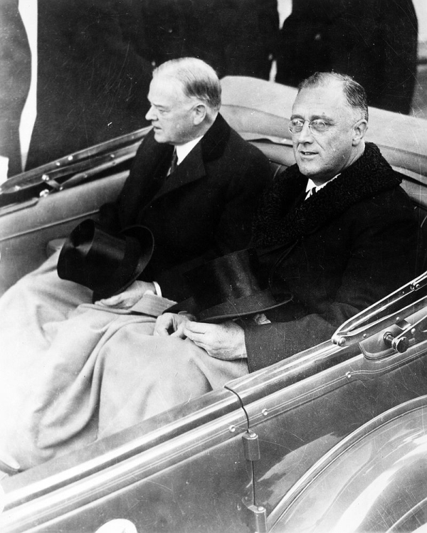 Herbert Hoover rides in a car with Franklin D. Roosevelt during the latter's inauguration on March 4, 1933.