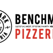 This is the restaurant logo for Benchmark Pizzeria