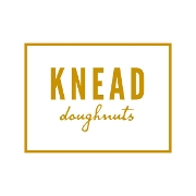 This is the restaurant logo for KNEAD Doughnuts