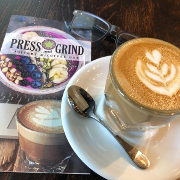 This is the restaurant logo for Press & Grind Cafe