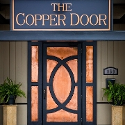 This is the restaurant logo for The Copper Door