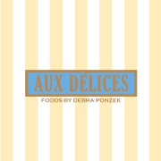 This is the restaurant logo for Aux Delices
