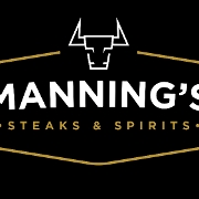 This is the restaurant logo for Manning's Steaks and Spirits