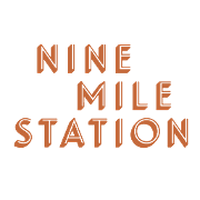 This is the restaurant logo for 9 Mile Station