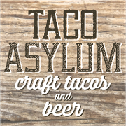 This is the restaurant logo for Taco Asylum