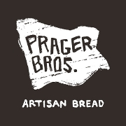 This is the restaurant logo for Prager Brothers Artisan Breads