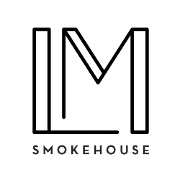This is the restaurant logo for Landmark Smokehouse