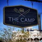 This is the restaurant logo for The Camp Restaurant