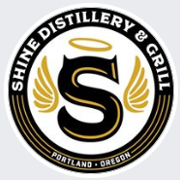This is the restaurant logo for Shine Distillery & Grill