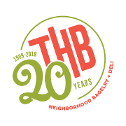 This is the restaurant logo for THB Bagelry + Deli