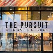 This is the restaurant logo for The Pursuit Wine Bar & Kitchen