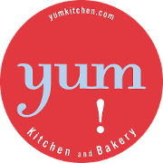 This is the restaurant logo for yum! kitchen & bakery