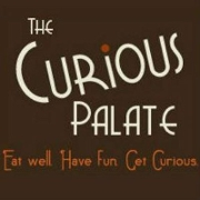 This is the restaurant logo for The Curious Palate