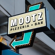 This is the restaurant logo for Mootz Pizzeria + Bar