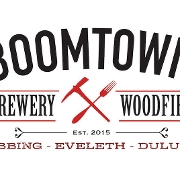 This is the restaurant logo for Boomtown | Eveleth, MN