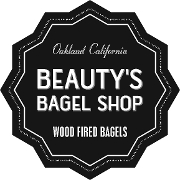This is the restaurant logo for Beauty's Bagel Shop