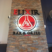 This is the restaurant logo for Elixir Bar & Grill