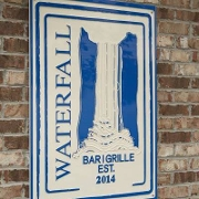 This is the restaurant logo for Waterfall Bar & Grille