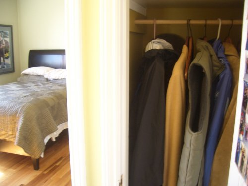 Right next to the entry is a coat closet with additional storage space.