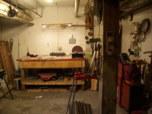 In the basement is a communal shop area.  Great for small projects, painting, etc.