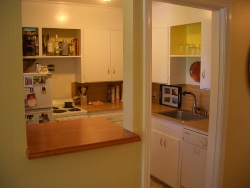 One of the best remodels I did was cutting out this hole and adding a folding shelve.  Really opens up the kitchen and living room.