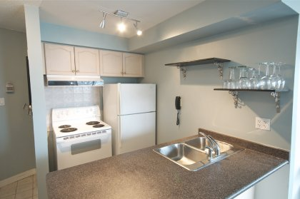 Designer Kitchen Cabinetry With A Breakfast Bar.