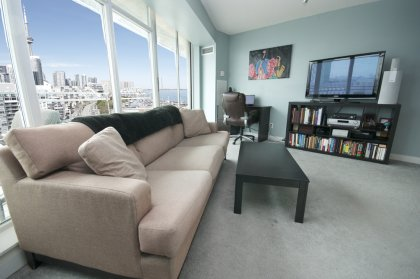 Bright Open Concept Floor-To-Ceiing Living & Dining Area Windows Facing C.N. Tower & Lake Views.