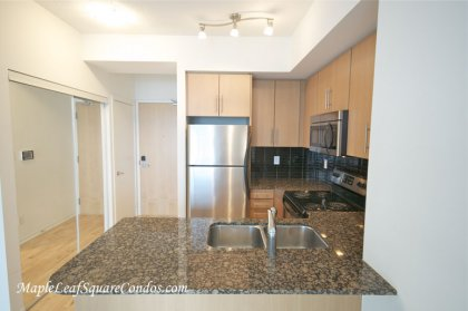 Designer Kitchen Cabinetry With Stainless Steel Appliances, Granite Counter Tops, Undermount Sink & A Breakfast Bar.